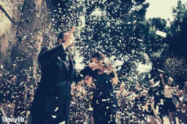 wedding happy ceremony for a couple wearing black confetti