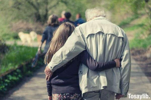 girl grand daughter and grandpa walking photo