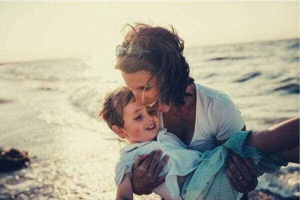 mom-and-son-happy-on-the-beach