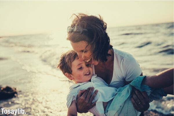 mom and son happy on the beach
