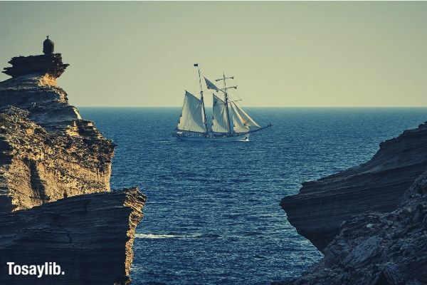 ship ocean cliff
