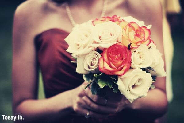 woman holding bouquet roses