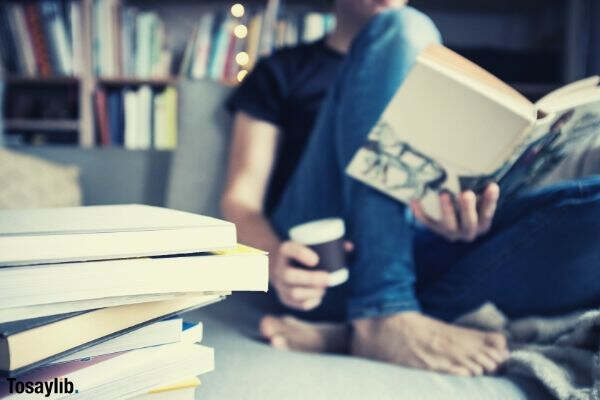 reading a book and having a coffee on couch