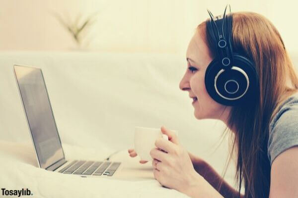 girl listening on headphones