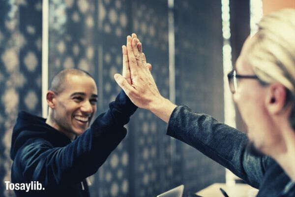 achievement agreement colleagues high five