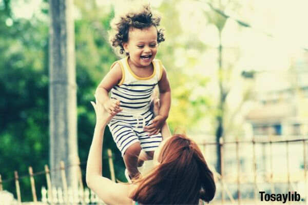 child thrown into the air by mom
