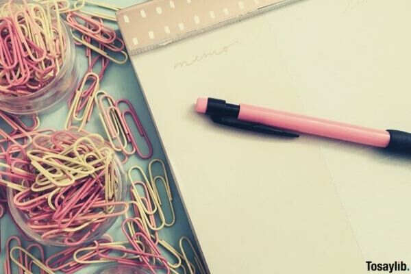 pink pink yellow abstract office planning pastel desk desk overhead top view paperclips flatlay