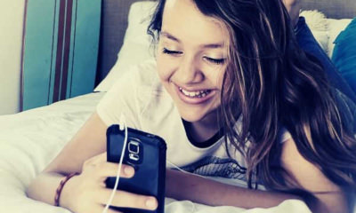 feature-06-people-relaxation-bed-bedroom-leisure-girl-smile-room-pretty-phone-mobile-watching-video