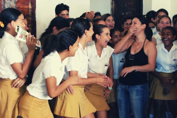 school-girls-laugh-with-their-teacher-in-trinidad-cuba
