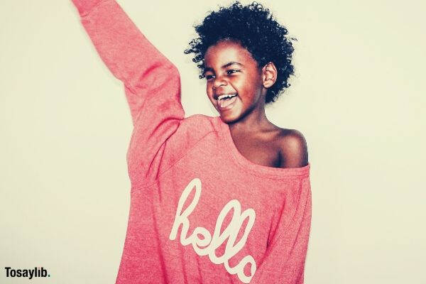 black american girl red long sleeves hello happy