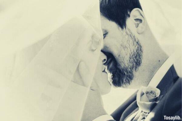 bride and groom wedding kiss