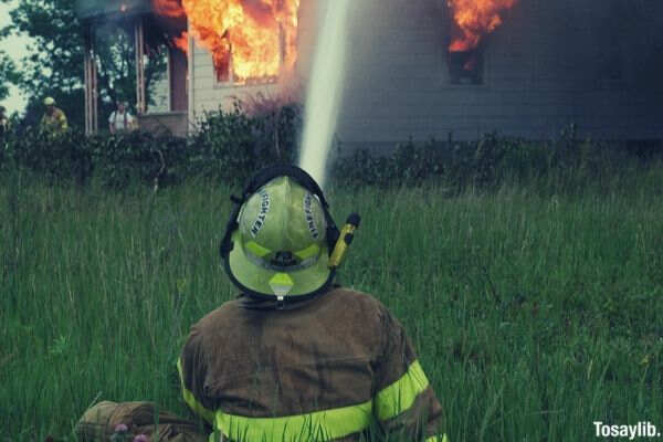fireman water hose fire