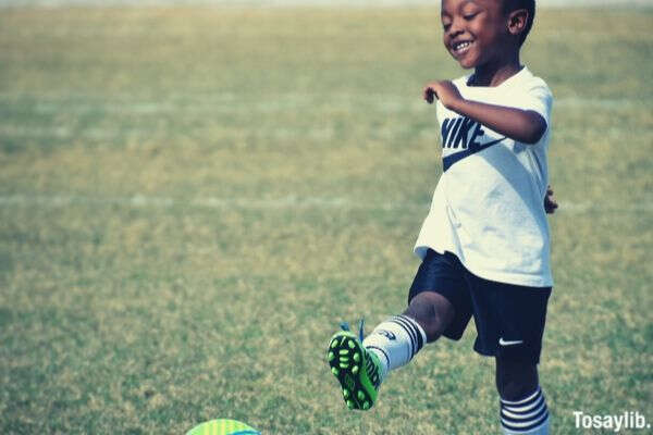 kid black american soccer smiling