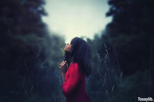 woman in red praying