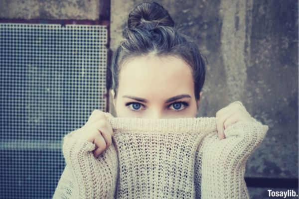 woman sweater hiding blue eyes