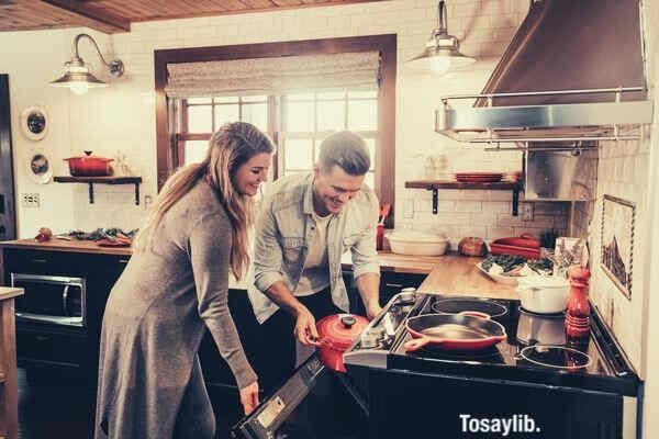 husband and wife cooking happily
