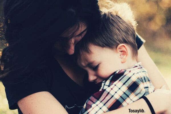 mom and son hug sad