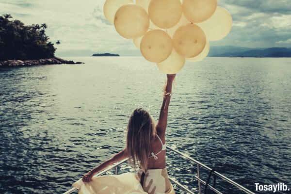 girl yacht balloons