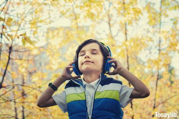 photo of a boy listeining in headphones