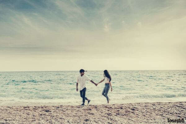 beach sand couple love relaxation leisure recreation couple in love