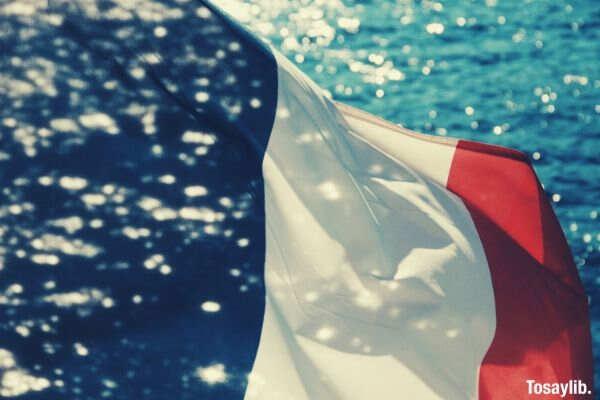 black red white flag sea