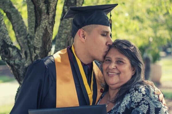 man-graduate-kiss-mommy-smiling