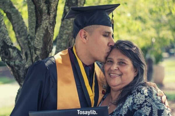 man graduate kiss mommy