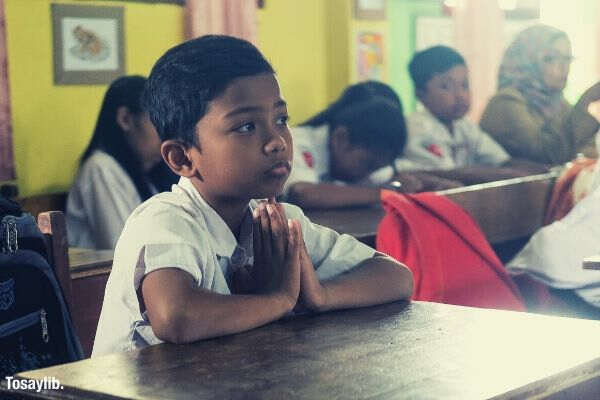 boy concentration young kids student studying students indonesian school uniform in class