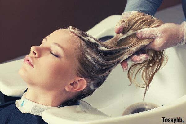 woman shampoo salon relax