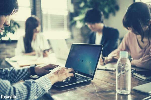 man using laptop office work