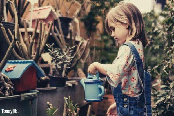 girl romper watering plants