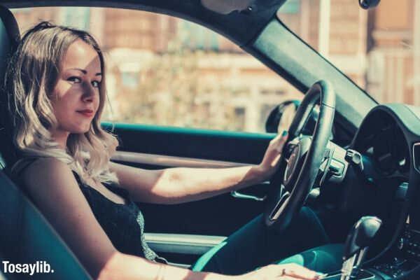 girl riding driving a car