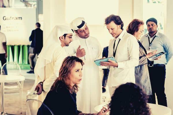 professional-businessmen-talking-exhibition