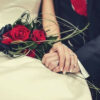 feature-wedding-couple-holding-hands-bouquet-roses