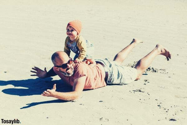 fun day with dad toddler playing sand