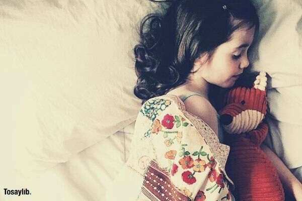 girl sleeping teddy bear bed blanket