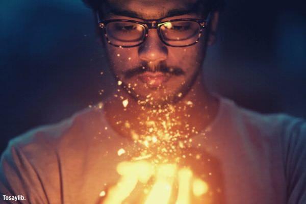 man holding light wearing eye glass