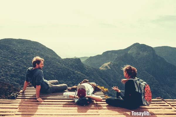 three men overlooking mountain photo