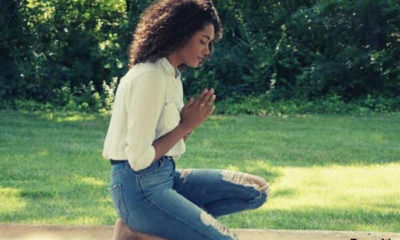 girl-grass-praying-curly-hair