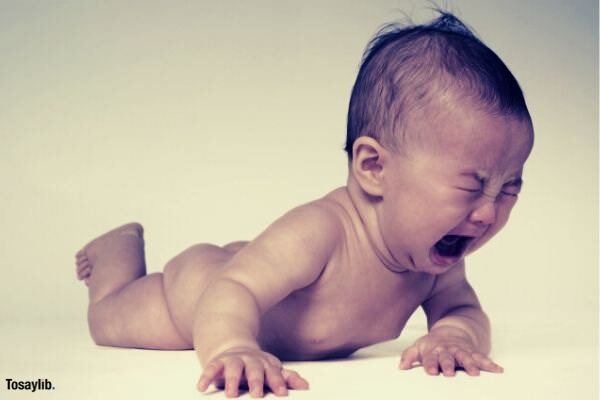 naked baby crying