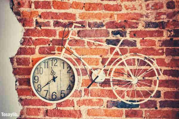 white bicycle analog wall clock bricks wall