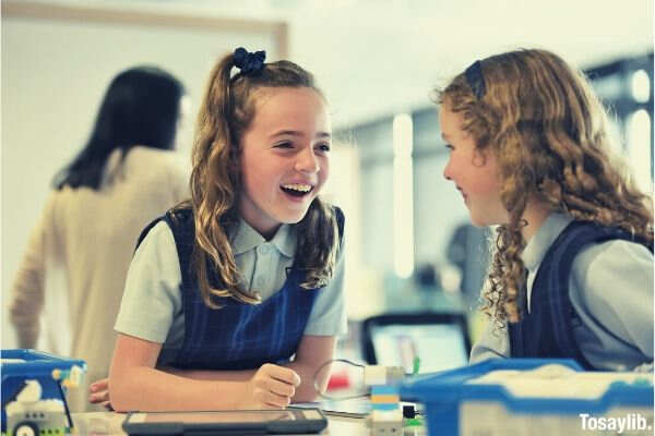 two girls laughing school