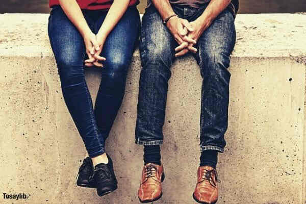 people sitting wearing skinny jeans legs black brown shoes