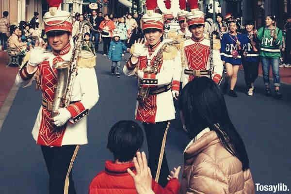disneyland band waving hands