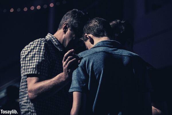 group of men praying over