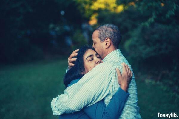 old couple hug eyes closed
