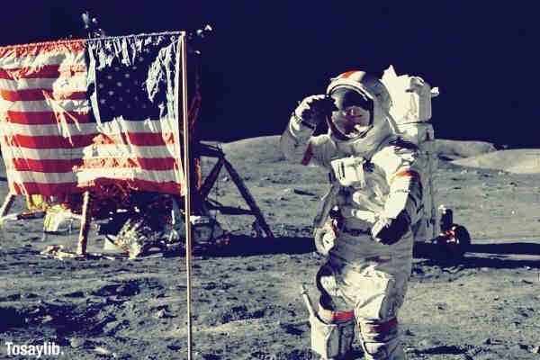 astronaut moon landing flag