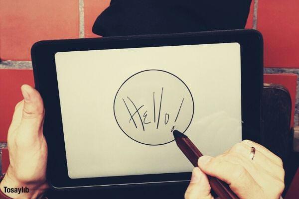 person writing hello white board