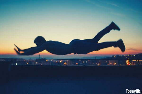 man planking on the air