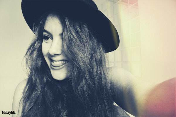 woman smiling black hat black white photo